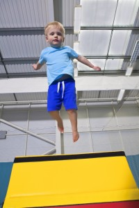 child jumping on box
