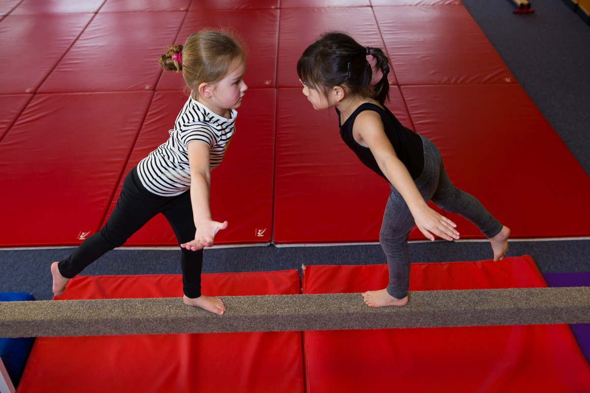 two children on balance beam