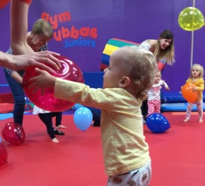 Toddler playing with balloon